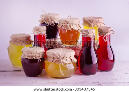 Preserved homemade fruits and berries jam in the jar. Rustic style. Selective focus. - stock photo