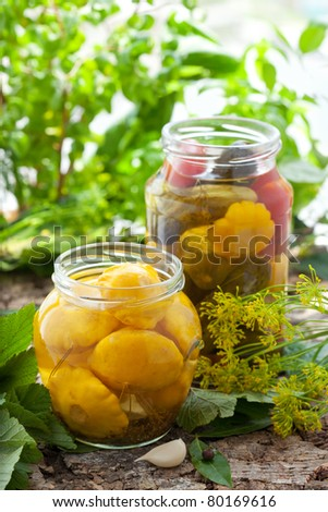 preserved patisson ,tomatoes and cucumbers in jars - stock photo