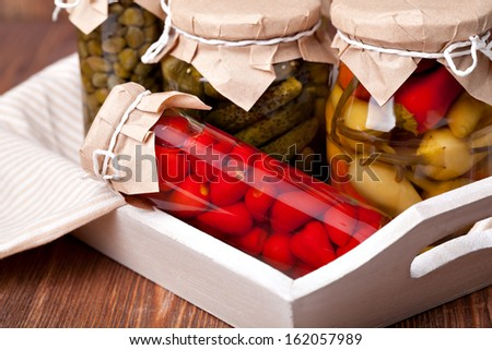 Preserved vegetable on a wooden table