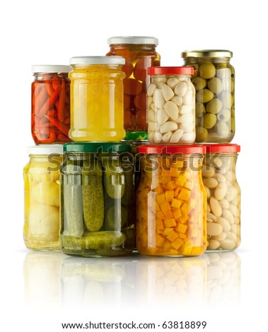 Preserved vegetables on white background - stock photo