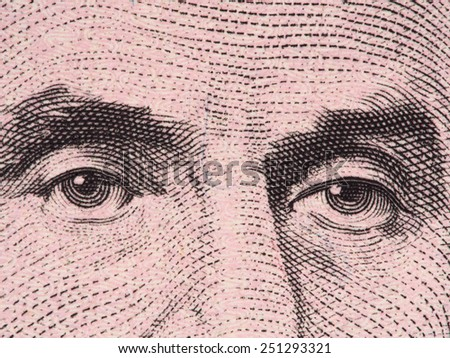President Abraham Lincoln eyes super macro on US five dollar bill, USA money closeup, 2013 series - stock photo
