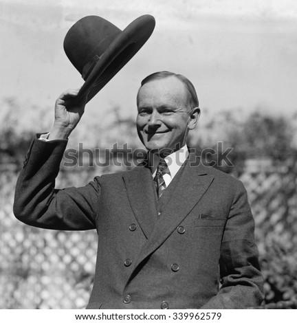 President Calvin Coolidge waves a hat presented to him by Smoki People of Prescott, Arizona. Ca. Sept-Oct. 1924 - stock photo