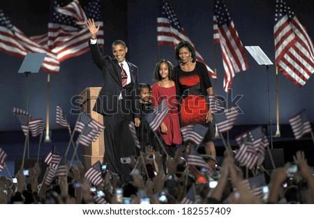 President Elect Senator Barack Obama, daughter Sasha Obama, daughter Malia Obama, wife Michelle Obama, at the Presidential Election Victory Speech, Grant Park, Chicago, IL, November 04, 2008 - stock photo