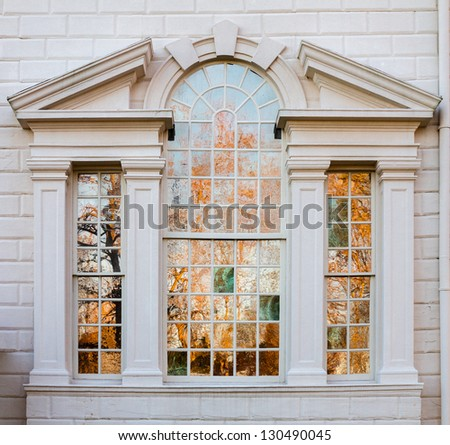 President George Washington home at Mount Vernon in Virginia with view of trees reflected in house windows - stock photo