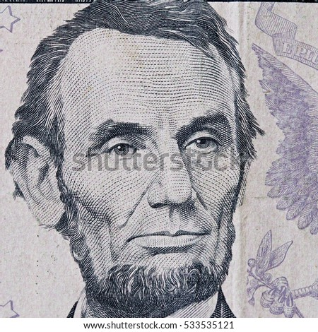 President Lincoln a close up on a five dollar bill. Shallow depth of field.