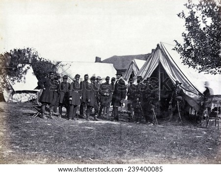 President Lincoln (1809-1865) on battle-field of Antietam with several officers outside tent. - stock photo