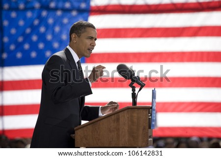 Presidential Candidate Barack Obama framed against American Flag at early vote for change Presidential rally, October 29, 2008 at Halifax Mall, Government Complex in Raleigh, NC - stock photo