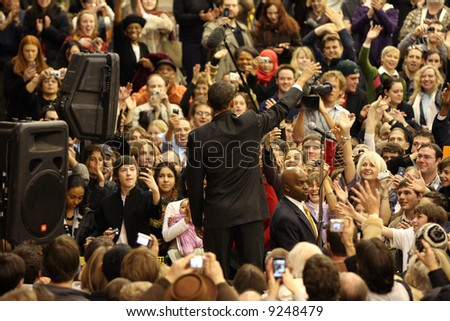 Presidential hopeful Barack Obama waving to fans and supporters at the University of Denver - stock photo