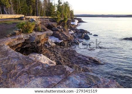 Presque Isle Park. The rugged Lake Superior shoreline in Presque Isle Park in Marquette, Michigan. - stock photo
