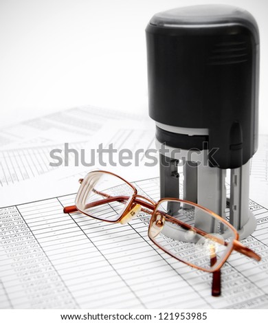 Press and glasses on documents. - stock photo