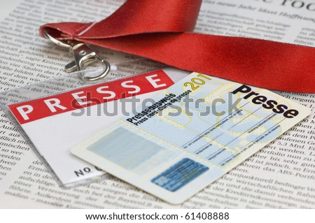 Press card on a newspaper - stock photo