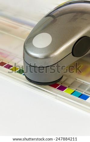 Press color management spectrophotometer device unit control - offset print - stock photo