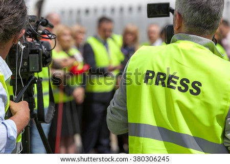 Press conference. Filming an event with a video camera. - stock photo