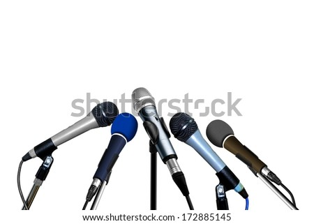 Press Conference Microphones over White - stock photo