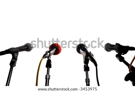 Press Conference (Row Of Microphones Waiting For A Speaker) - stock photo