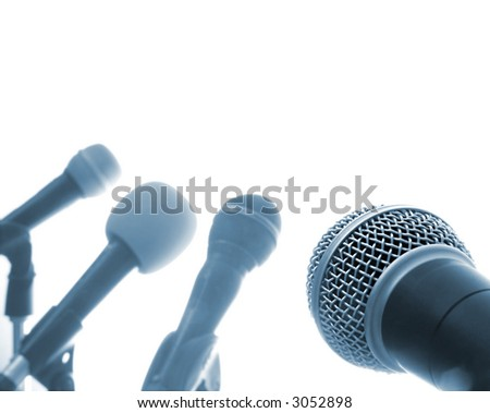 Press Conference (Row Of Microphones With One In The Foreground) - stock photo