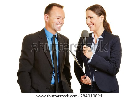 Press officer of a company giving interview to journalist with a microphone - stock photo