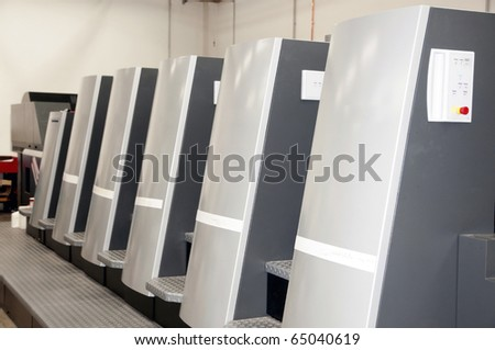Press printing (printshop) - Offset machine. Offset press is a printing machine designed to produce fine quality reproductions. - stock photo