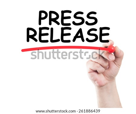 Press release concept made by a human hand holding a marker on transparent wipe board - stock photo