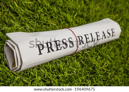 press release on green meadow - stock photo