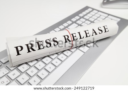 press release written on newspaper - stock photo