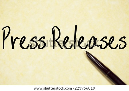 press releases text write on paper  - stock photo