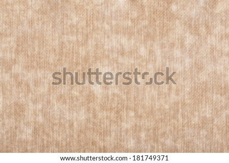 Pressed brown old worn synthetic packing paper background that was became weary highlighted by sun or day light - stock photo