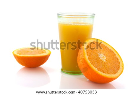 Pressed orange juice in a glass with cut fruit