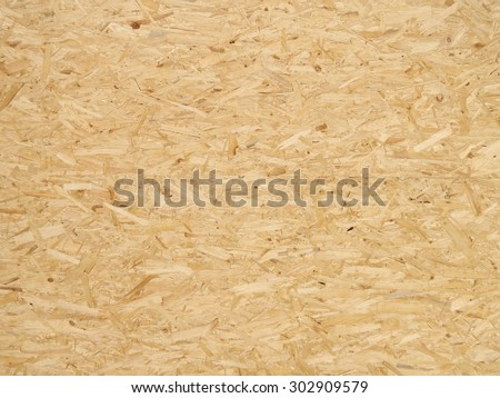 Pressed wooden panel background, seamless texture of oriented strand board - OSB - stock photo