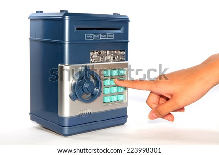 Pressing code on the safe - stock photo