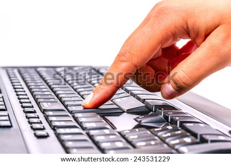 Pressing enter button on the computer keyboard - stock photo