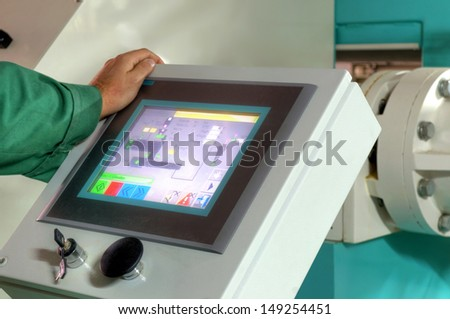 pressing important technology button at control panel in plant - stock photo