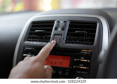 pressing red triangle car hazard warning button - stock photo