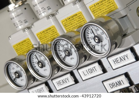 Pressure controls of coil winding machine - stock photo