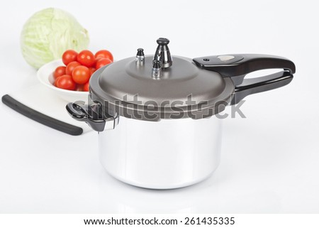 pressure cooker with gray top on white background - stock photo