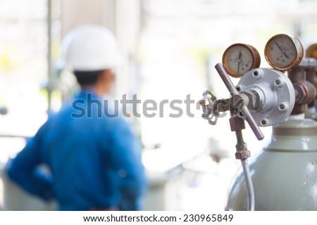pressure gauge for control nitrogen pressure in let and out let,people background - stock photo