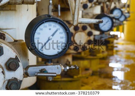 Pressure gauge for monitoring measure pressure in oil and gas process, Offshore oil and gas industry.Oil and gas wellhead platform in the gulf or the sea, The world energy. - stock photo