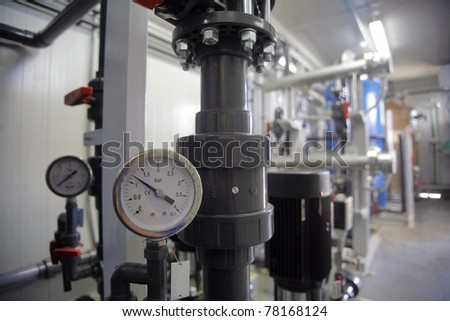 Pressure gauge inside an industrial room - stock photo