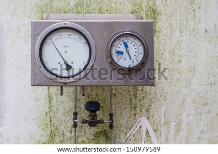 Pressure gauge installed in a large pressure vessel.