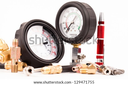 pressure gauges and tools isolated on white - stock photo