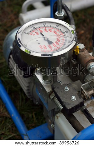 Pressure in machine id measured with this barometer, liquid in instrument is anti-frost glycerine oil - stock photo