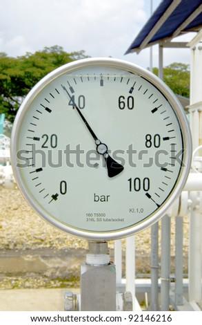 Pressure meter mention at 39 bar at metering gas station. - stock photo