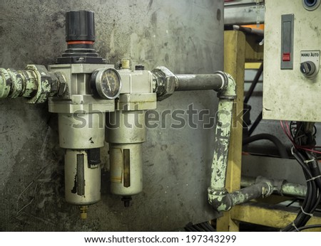 pressure meter on a machine - stock photo