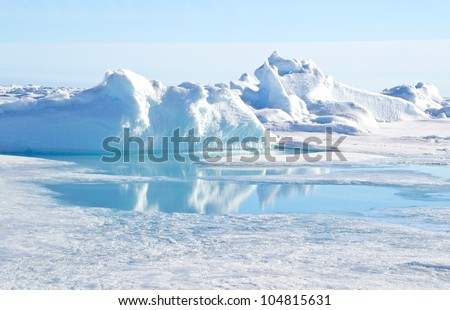 Pressure ridge and melt water at the Geographic North Pole - stock photo