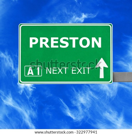 PRESTON road sign against clear blue sky