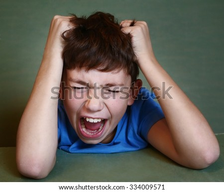 preteen boy have nervous breakdown because of difficult large homework - stock photo