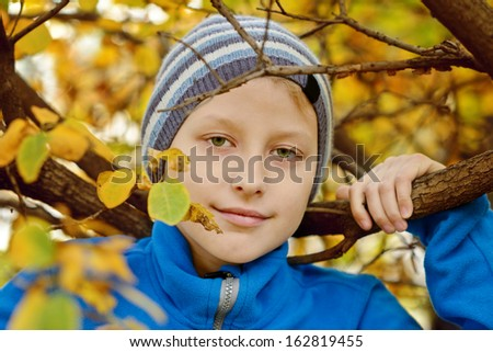 preteen boy in fall time - stock photo