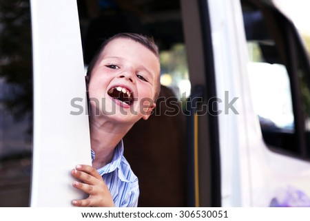 preteen boy portrait shout from the car door - stock photo