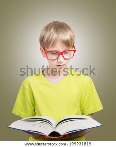 Preteen boy reading a book - stock photo