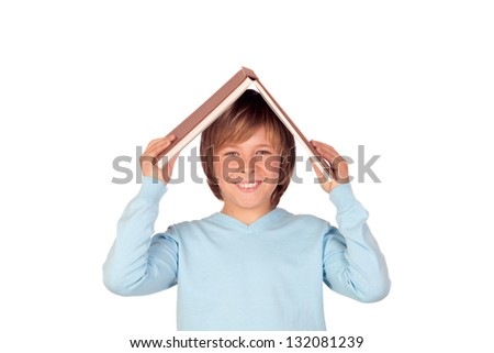 Preteen boy with a big book oh his head isolated on white background - stock photo